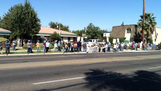 Farm workers protest outside a regional labor board in Visalia, CA to be allowed to vote to decertify the UFW.