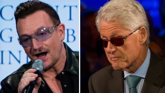 Bono and former President Bill Clinton impersonate each other at the Clinton Global Initiative annual meeting in New York.