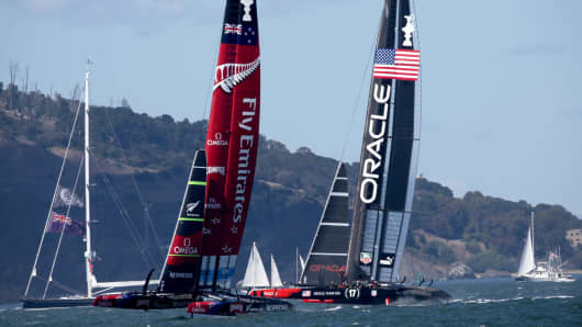 Oracle Team USA and Emerites Team New Zealand during final America's Cup race on September 25, 2013 in San Francisco, California.