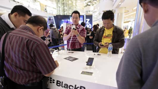 Customers view the BlackBerry Z10 smartphone in Indonesia.