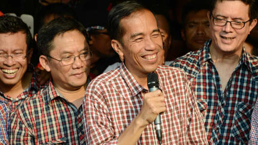 Governor Joko Widodo smiles as he gives his remarks in a press conference in Jakarta.