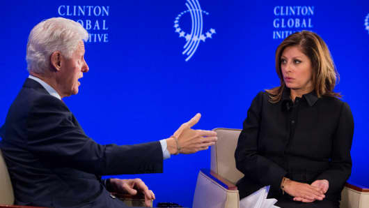 Maria Bartiromo speaks with Bill Clinton at the CGI 2013 annual meeting in New York.