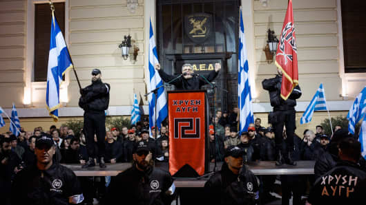 Golden Dawn party leader Nikolaos Mihaloliakos delivering a speech to members in February.