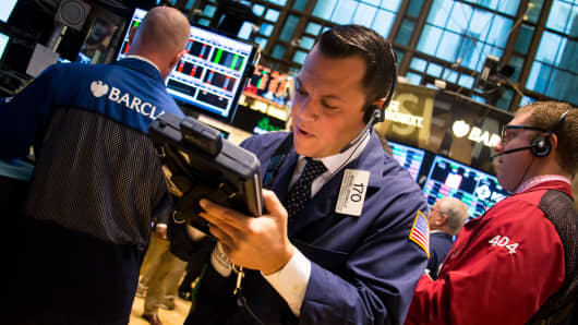 Traders work the floor on the NYSE the first day of the government shutdown.