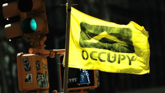 Occupy Wall Street participants take part in a protest to mark the movement's second anniversary in New York, September 17, 2013.
