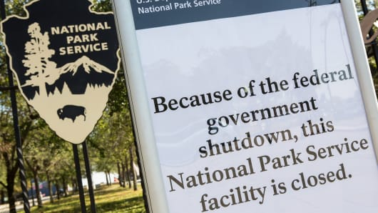 A sign at the entrance to the Fort Sumter National Monument informs visitors it is closed because of the federal government shutdown October 2, 2013 in Charleston, South Carolina.