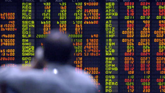 A trader watches stocks trading at the Philippine Stock Exchange.