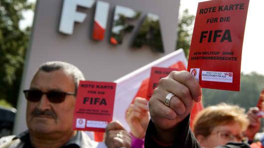"Demonstrators outside FIFA's headquarters in Zurich after a newspaper report said Nepalese construction workers treated like ""slaves"" have died working on World Cup projects in Qatar."