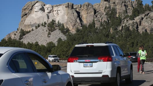 With the park closed, tourists stop along the highway to view Mount Rushmore National Memorial in Keystone, SD.