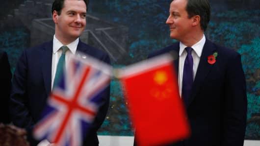Prime Minister David Cameron (R) and Chancellor George Osborne (L)