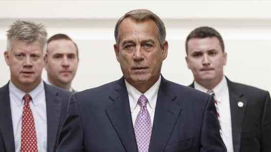 House Speaker John Boehner of Ohio walks to a Republican strategy session on Friday.