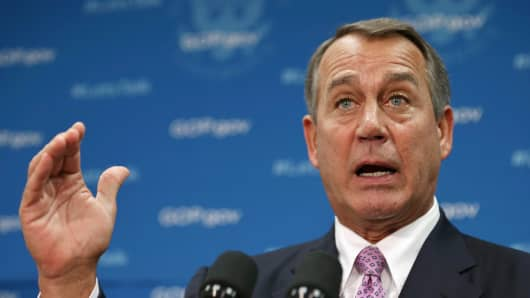 Speaker of the House John Boehner (R-OH) answers reporters' questions during a news conference after a House Republican caucus meeting at the U.S. Capitol October 4, 2013 in Washington, DC. 'This isn't some damn game,' Boehner said about the current federal government shutdown.