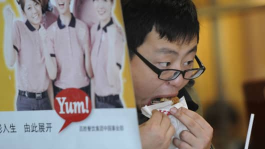 A customer eats Kentucky Fried Chicken (KFC) in an outlet in Shanghai on January 9, 2013. Chinese customers of KFC.