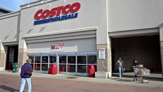 Customers enter and exit a Costco Wholesale Corp. store in Mount Prospect, Illinois.