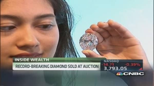 Sotheby's eye-popping 118-carat diamond sets record price