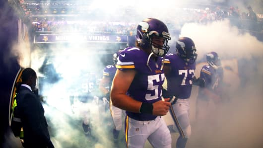 The Minnesota Vikings run on to the field before their game in September against the Pittsburgh Steelers in London.