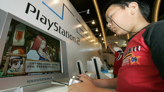 A boy plays with Sony's Playstation 2 at an animation fair in Shanghai, China.