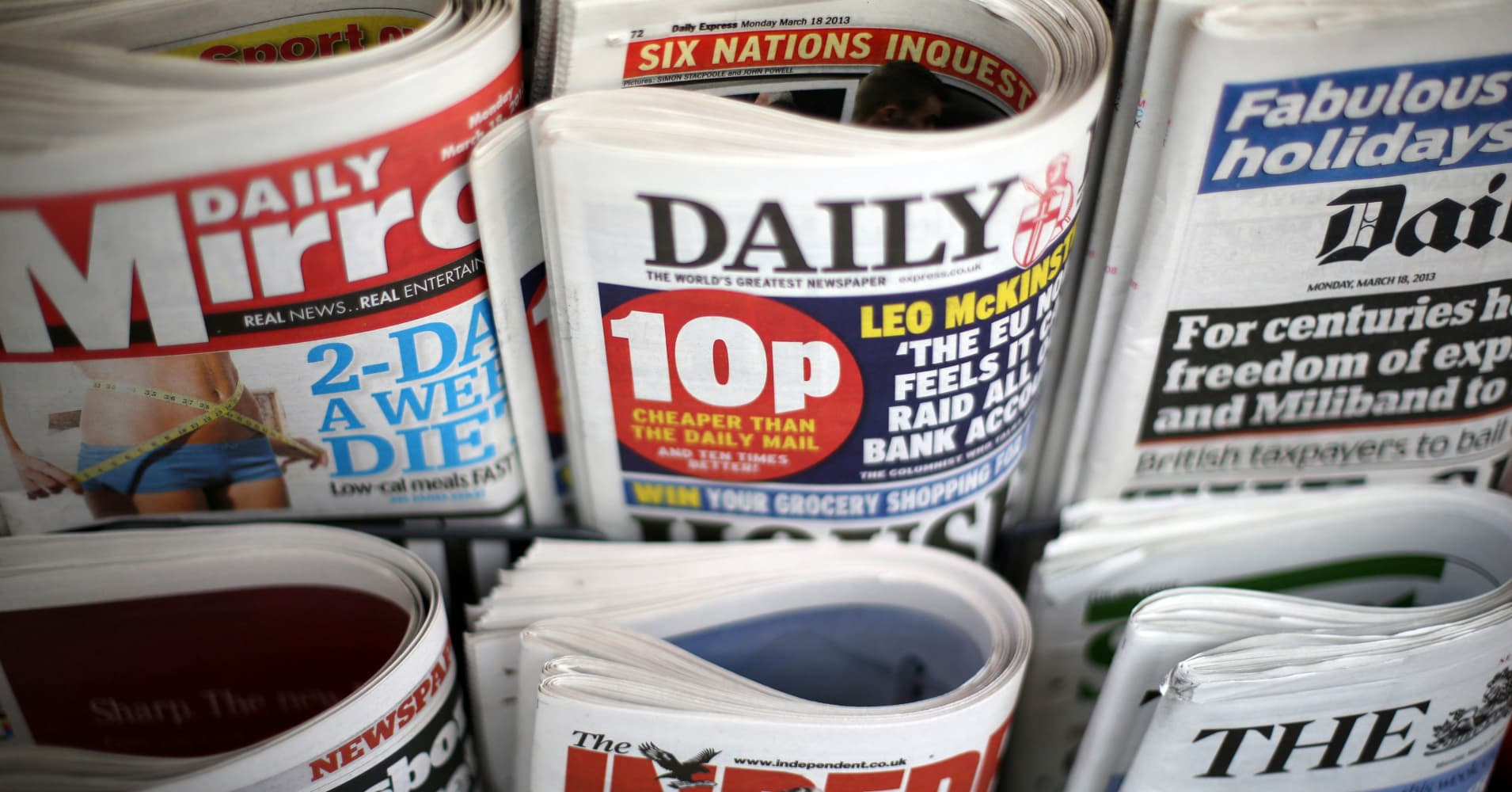 Daily Mail publisher reports 13 pct drop in profit, shares sink