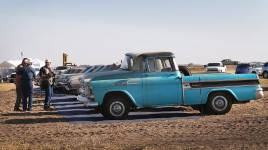 A 1958 Chevrolet Cameo truck is lined up for auction with other cars and trucks in a field on the Lambrecht family farm on September 26, 2013 in Pierce, Nebraska.