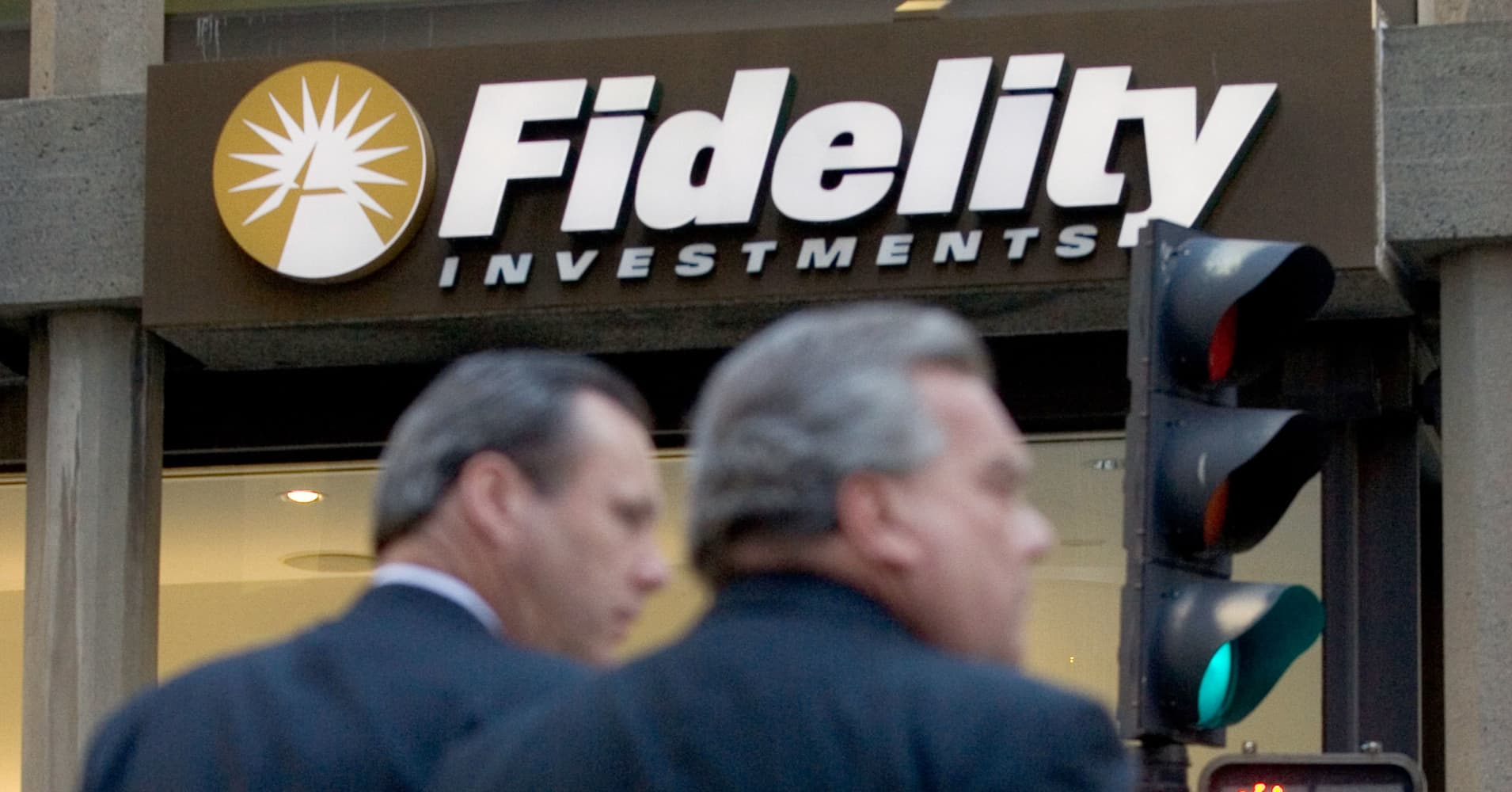 Pedestrians pass a Fidelity Investments office in Boston.