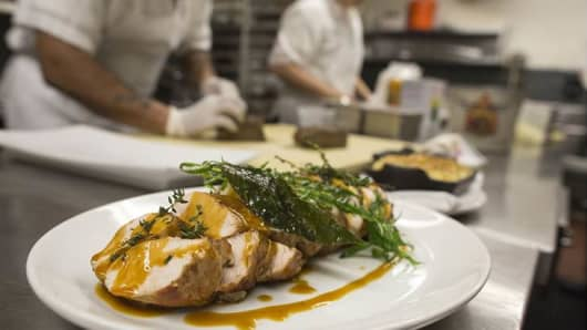 """Chefs prepare a special """"Thanksgivukkah"""" menu in the kitchen at Kutsher's Tribeca in New York City to celebrate the rare convergence of Hanukkah and Thanksgiving."""