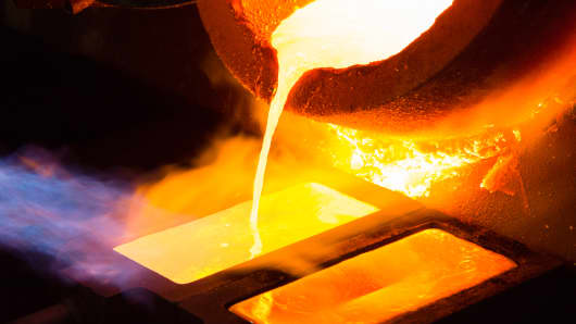 Molten gold pours from a crucible into a heated mold after refining at the Kaloti Jewellery factory in Sharjah, United Arab Emirates.