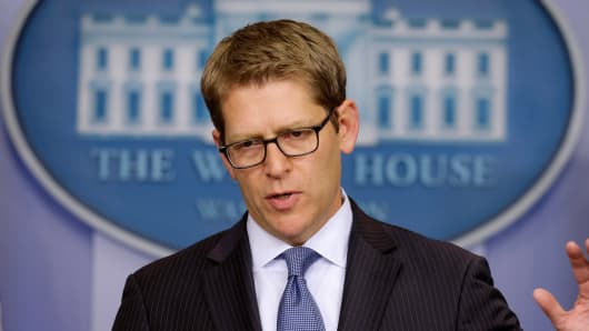 White House press secretary Jay Carney gestures during his daily news briefing at the White House in Washington, Friday, Oct. 11, 2013, where he spoke about the budget and partial government shutdown.