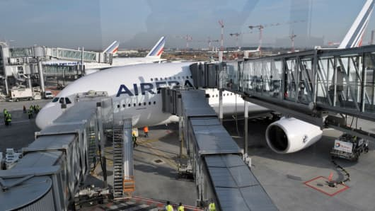 Passengers are boarding on an Air France A380 at Roissy Charles-de-Gaulle airport outside Paris.