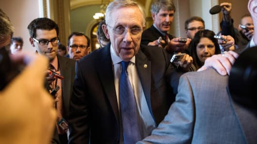 Senate Majority Leader Harry Reid (D-NV) walks through the Capitol building on October 14, 2013 in Washington, DC