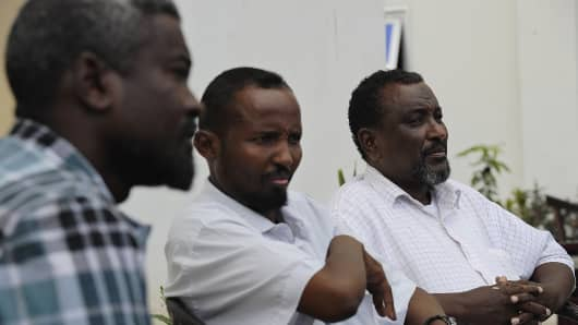 Mohamed Abdi Hassan (R), one of Somalia's most notorious pirate chiefs.