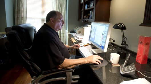 Graphic designer Tom Sadowski, 65, who delayed his retirement, works from home in Sterling, Va.