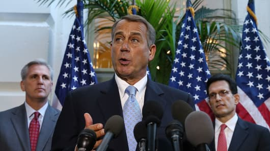 House Speaker John Boehner (R-OH) (C) speaks to the media while flanked by House Majority Leader Eric Cantor (R-VA) (R) and U.S. Rep. Kevin McCarthy (R-CA) folowing a House Republican caucus meeting at the U.S. Capitol.