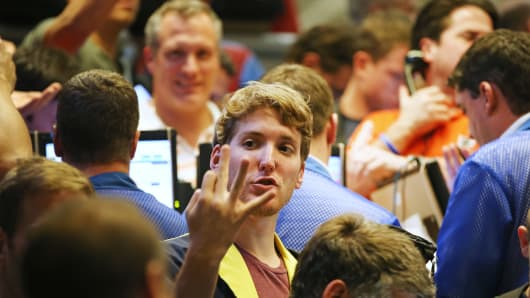 A trader signals an offer in the Standard & Poor's 500 stock index options pit at the Chicago Board Options Exchange (CBOE).
