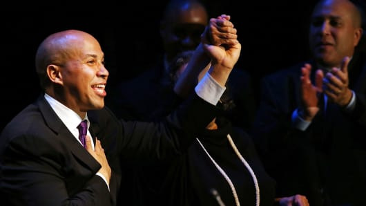 Cory Booker, Newark Mayor and newly-elected Democratic U.S. Senator, speaks after winning a special election against Republican Steve Lonegan on October 16, 2013 in Newark, New Jersey.