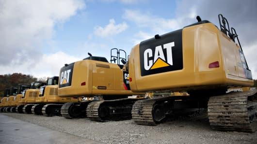 Caterpillar Inc. excavators sit on display at the Altorfer CAT dealership in Bettendorf, Iowa.
