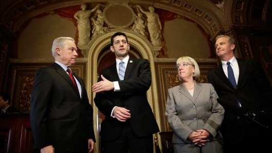 Members of the bipartisan budget conference (L-R) Sen. Jeff Sessions (R-AL), Rep. Paul Ryan (R-WI), Sen. Patty Murray (D-WA) and Rep. Chris Van Hollen (D-MD) discuss their initial meeting at the U.S. Capitol October 17, 2013 in Washington, DC.