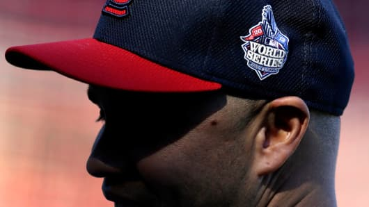 St. Louis Cardinal Carlos Beltran wears the World Series logo on his cap during baseball practice on Sunday  in St. Louis.