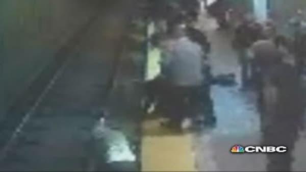 Boston woman falls onto train tracks, is rescued