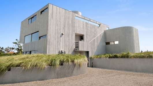 This two-story oceanfront home in Amagansett recently sold for $11 million. It has four bedrooms, two baths and a tennis court.