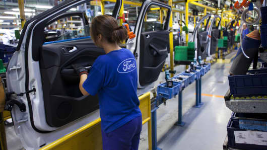 A worker on the production line at the Ford plant in Almussafes, Spain