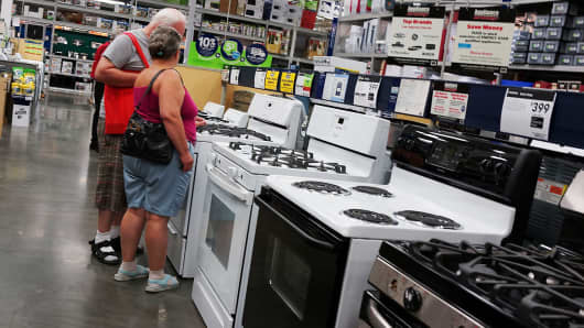People shop for stoves in a Manhattan home furnishing store in New York City.