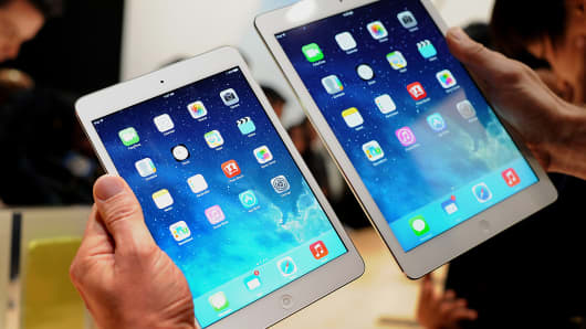 The Apple iPad Mini, left, and iPad Air are displayed in October at the Yerba Buena Center in San Francisco.