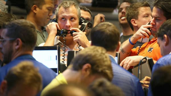 Traders take orders in the Standard & Poor's 500 stock index options pit at the Chicago Board Options Exchange (CBOE) in Chicago, Illinois.