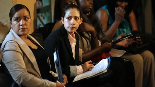 Job seekers wait to interview with company representatives at the Hire Live Job Fair in El Segundo, California.