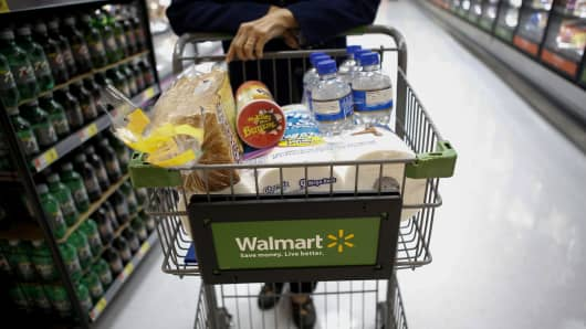 A customer pushes a shopping cart during the grand opening of a Wal-Mart Stores Inc. location in the Chinatown neighborhood of Los Angeles, California.