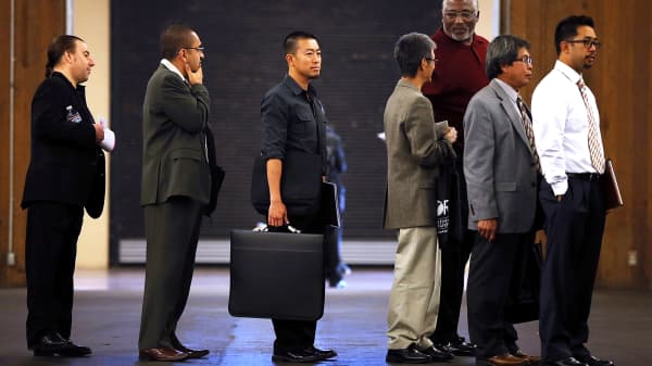 Job seekers line up to meet with recruiters during the Job Hunters Boot Camp in San Mateo, California.