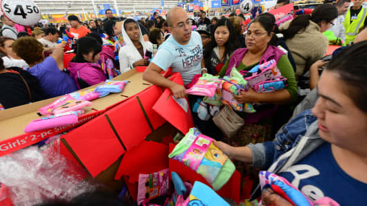People get an early start on Black Friday shopping deals last year at a Walmart Superstore in Rosemead, Calif.