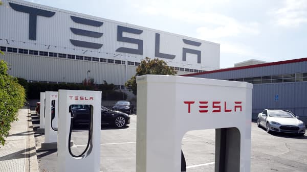 A row of new Tesla superchargers outside the company's factory in Fremont, Calif.