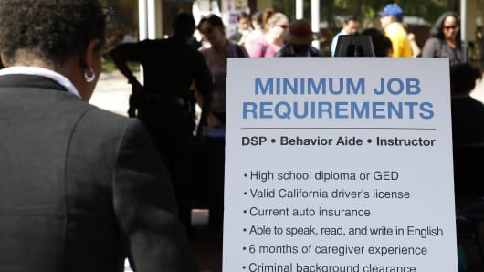 The minimum requirements for aide and caregiver employment are listed on a poster during the Fall Classic Hiring Spree event at Los Angeles City College in Los Angeles.