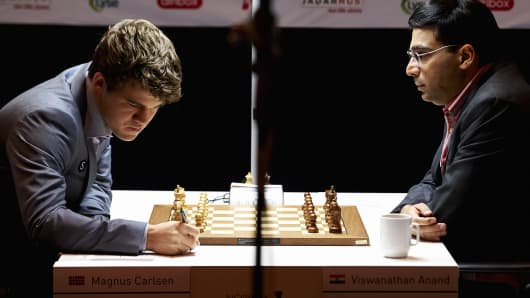 India`s Viswanathan Anand (R) plays against Norway`s Magnus Carlsen during the Norway Chess 2013 Blitz tournament in Sandnes near Stavanger, on May 9, 2013.